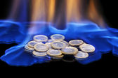 Coins on fire — Stock Photo