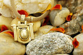 Necklace on stones  — Stock Photo