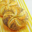 Kaiser roll with puppy seed — Stock Photo #15631495