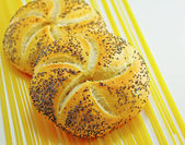 Kaiser roll with puppy seed — Stock Photo