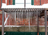 Icicle on Metal Grate — Stock Photo