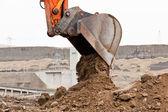 Bucket Unloading Dirt — Stock Photo