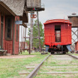 Red Caboose at Station - Photo