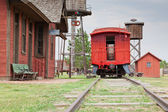 Red Caboose at Station — Stock Photo