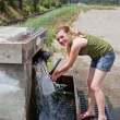 Photo: Teen Getting Spring Water