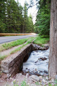 Water Under Road with Headlights — Stock Photo