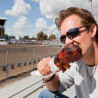 Man Eating a Turkey Leg — Stock Photo