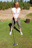 Tee off with cleavage — Stock Photo