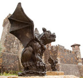 Gargoyle with Castle — Stock Photo