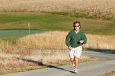 Man Jogging at Golf Course — Stock Photo