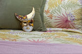 Painted Mask on a Bed — Stock Photo