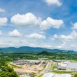 Panorama of Estates Zone under Construction with Blue Sky field. - Stock Photo