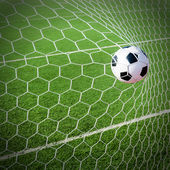 Soccer Football in Goal net. — Stock Photo