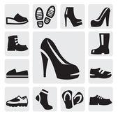 Botas de hombres y mujeres — Vector de stock