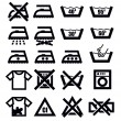 Washing signs and clothes - Stock Vector