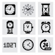 Vector black clocks icons — Stock Vector