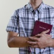 Christian Teenager Holding a Bible - Stock Photo