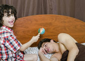 Young boy awakes his elder brother by making noises — Stock Photo