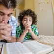 Young Family Praying - Stock Photo