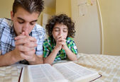 Young Family Praying — Stock Photo