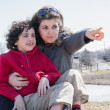 Hispanic Mother Signaling Something in the Distance — Stock Photo
