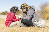 Single Mother and Son Praying Outdoors — Fotografia Stock