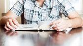 Hispanic teenager reading the Bible — Stock Photo
