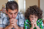 Brothers praying at home — Stock Photo