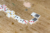 Row of Dominoes in a Table — Stock Photo