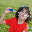 Young Boy Enjoying Blowing Soap Bubbles Outdoors — Stock Photo