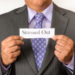 Stock Photo: Business mwearing suit and holding sign. Neat business person wearing suit and tie. Holding sign.