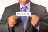 Business man wearing a suit and holding a sign. Neat business person wearing a suit and tie. Holding a sign. — Stock Photo