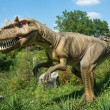 Stock Photo: Different kind of dinosaurs in outdoor park. Beautiful real size dinosaurs in natural background.