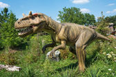 Different kind of dinosaurs in an outdoor park. Beautiful real size dinosaurs in a natural background. — Fotografia Stock