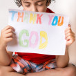 Christian child thanking God. Boy praying,praising and thanking God. Religious kid over a white background — Stock Photo