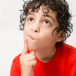 Hispanic Child Expressions of sadness, wondering and dispair. Boy with curly hair making different mood expressions. White background picture of a kid making face expressions — Stock Photo #30943123