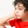 Hispanic Child Expressions of sadness, wondering and dispair. Boy with curly hair making different mood expressions. White background picture of a kid making face expressions — Stock Photo