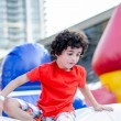 Child Playing in Inflatable Playground — Stok fotoğraf