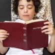 Foto Stock: Child Reading Bible