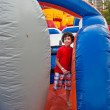 Child Playing in Inflatable Playground — Foto de Stock
