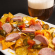 Постер, плакат: Nachos with sausage and beer