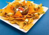 Traditional Nachos with Olives and Jalapenos — Stok fotoğraf