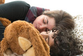 Family life.Single mother sleeping with son — Stock Photo