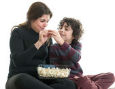 Single mom and son eating popcorn — 图库照片