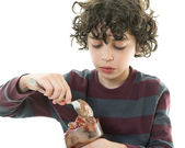 Child eating chocolate icecream — Stock Photo