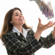 Woman throwning money in the air — Stock fotografie