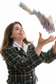 Woman throwning money in the air — Stockfoto