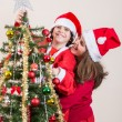 Family enjoying the Christmas — Stockfoto
