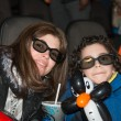 Stock Photo: Single Mother and son at movies