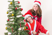 Hispanic Family and Child having fun decorating a Christmas tree — Foto de Stock